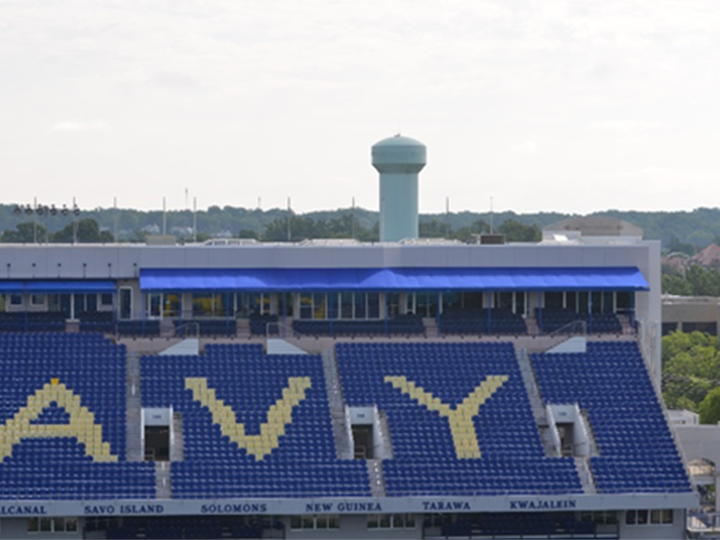 portion of navy stadium showing the a v and y in the stands