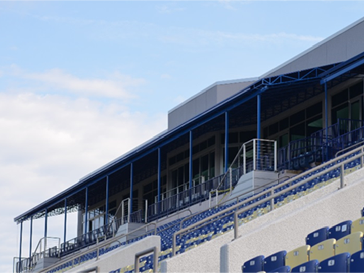 view of navy stadium with awnings over box seating