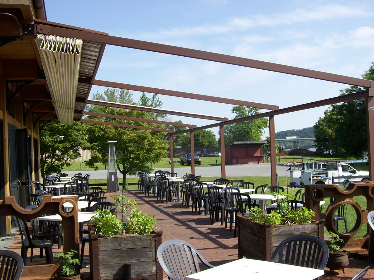 restaurant with a newly installed pergola that is open all the way since it is nice weather