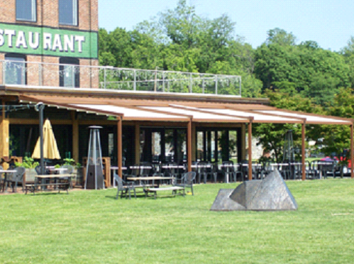 reatuarant sign in green with a view of the pergola completely closed
