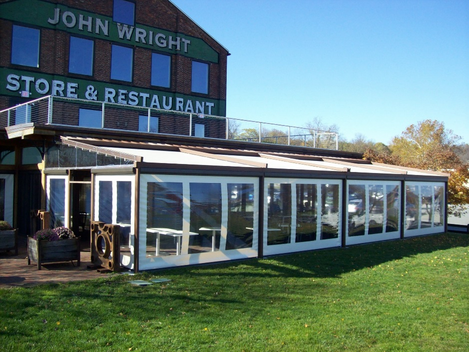 john wright store and restaurant with pergola closed and roll down screens pulled down