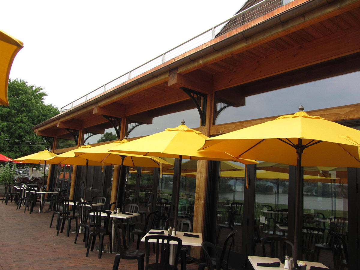 Yellow Umbrellas Opened Up Over Tables And Lined Up