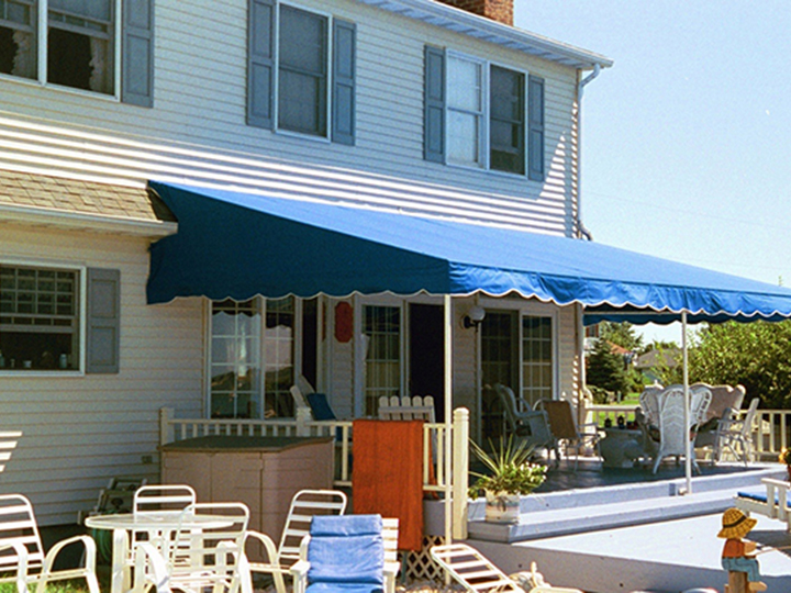 Blue Awning Extended Out Over A Patio