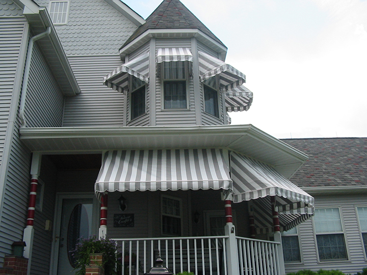 Small window fabric awnings by Sunair
