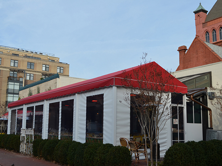 red canopy with white roll down screens for restaurant seating area