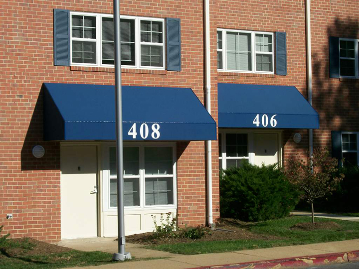 blue fabric canopies for an office building with numbers 408 and 406 - Commercial Canopies Retractable Deck & Patio Awnings SUNAIR