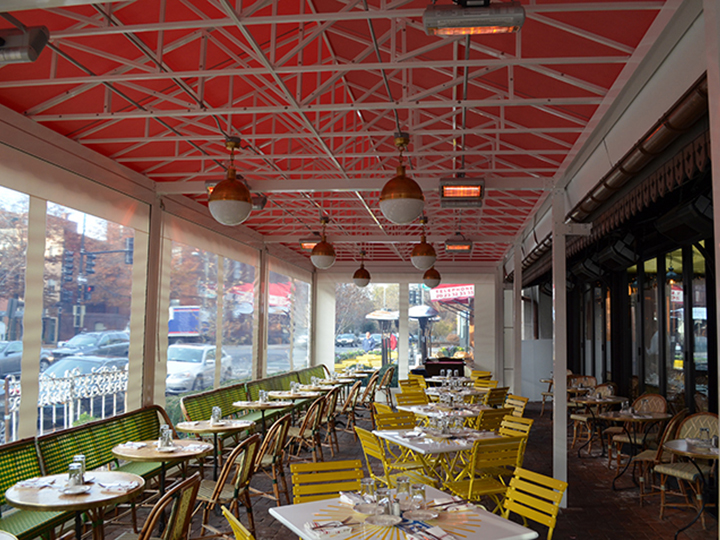 restaurant seating area with red canopy providing solar protection