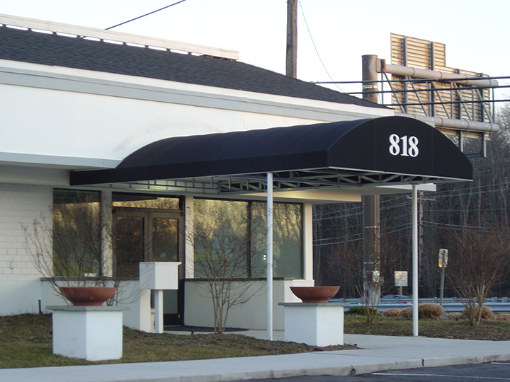 long fabric canopy with number 818 on the front & Commercial Canopies | Retractable Deck u0026 Patio Awnings | SUNAIR