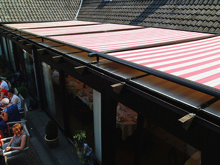 view from above of a coral and white striped conservatory awning