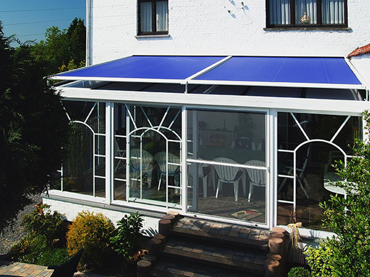 blue conservatory awning over top a small dining area