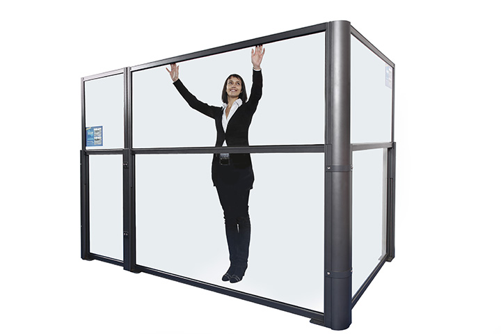 woman showing how a glass divider can be lowered with it starting in the up position