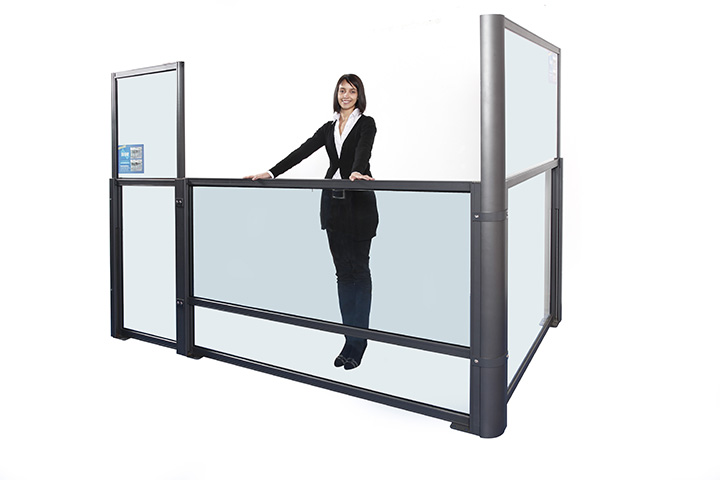 woman in black suit showing how to lower a glass divider