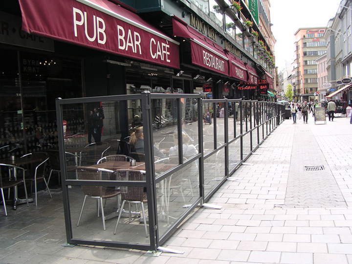 pub bar cafe red sign with outdoor glass dividers and seating area