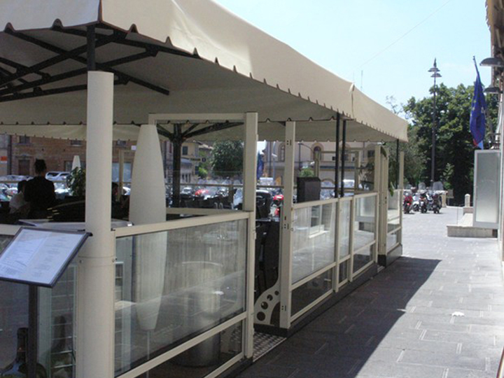 cream awning that is raised up a bit and a menu stand in the bottom left corner