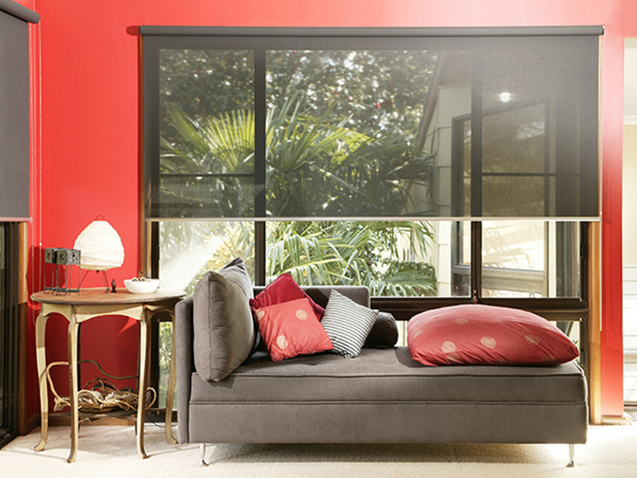 red interior room with a tan sofa an awning shade