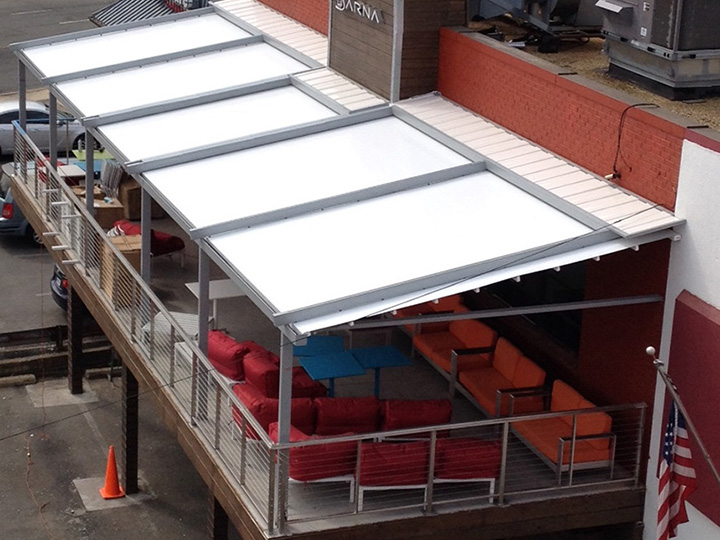 White Awning Pergola Over A Restaurant Deck