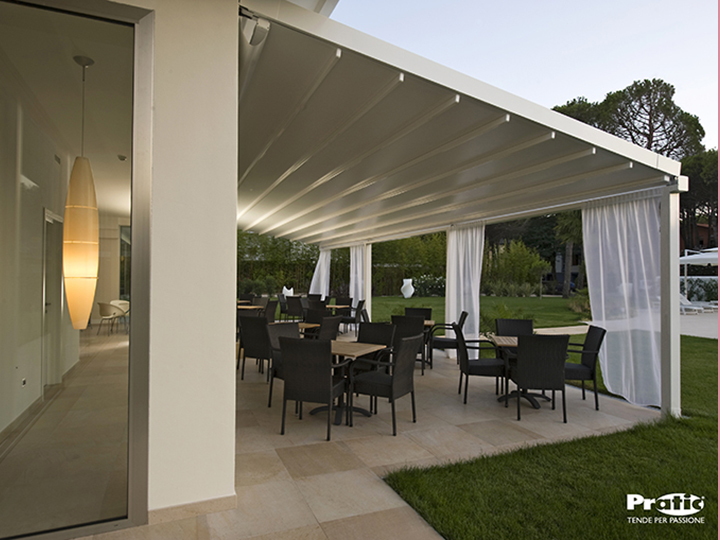 large white pergola over outdoor seating area in a garden-like atmosphere