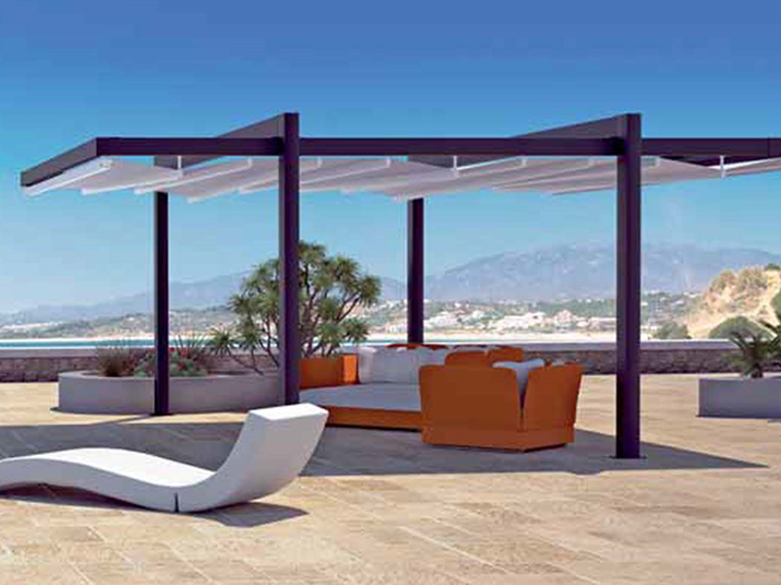 A pergola awning on a deck with couches and chairs