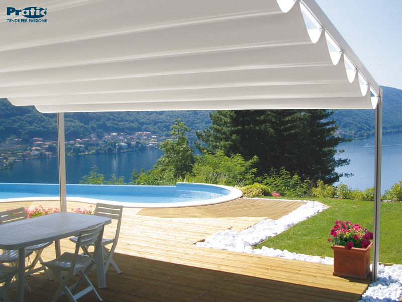 white awning over outdoor patio with pool and lake view