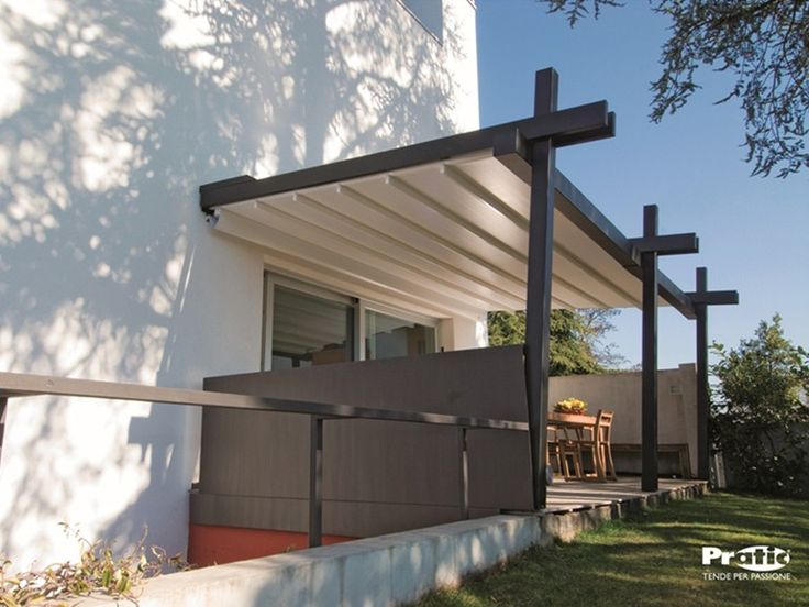 pergola with cream cover and wooden supports over patio