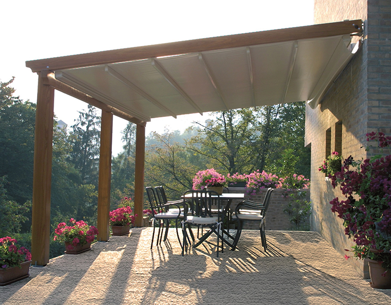 Genial Wooden Pergola Stretched Over Patio With Garden Of Flowers Surrounding The  Patio