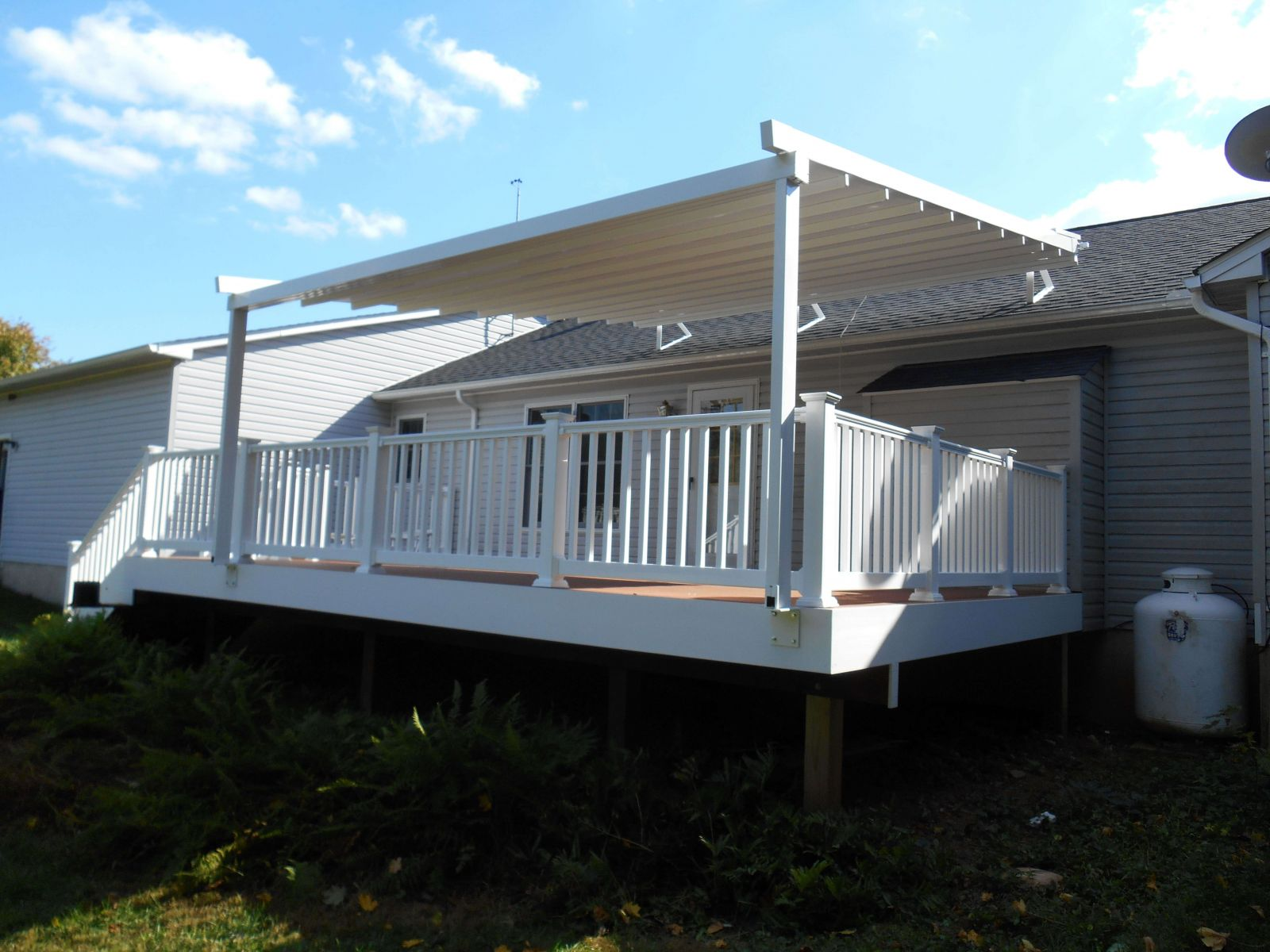 Level Pergola awning mounted to a sloped Roof.JPG