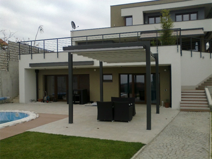Pergola Awning In The Back Of A House By The Pool Area