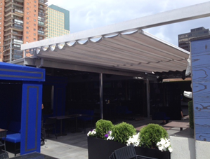 pergola awning system mounted between two walls