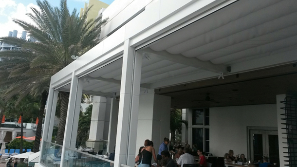 Tecnic retractable Pergola shade on a metal structure.jpg