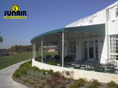Canopy%20on%20patio%20with%20round%20wall%20by%20Sunair.JPG