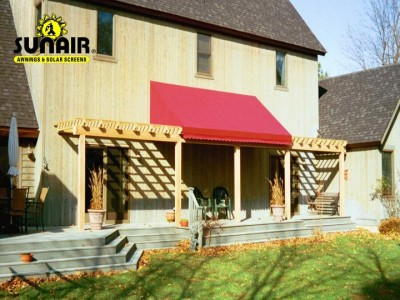 Sunair%20fabric%20canopy%20over%20wood%20trellis.JPG