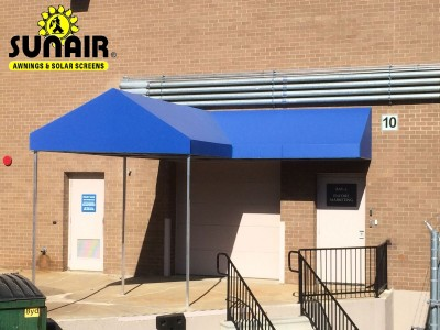 Blue V shaped canopy over entrance