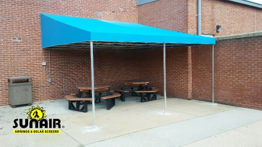 Canopy covering patio furniture