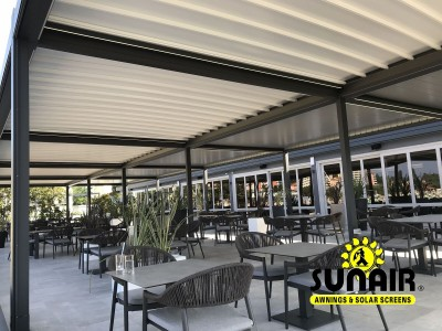 Awning over restaurant furniture