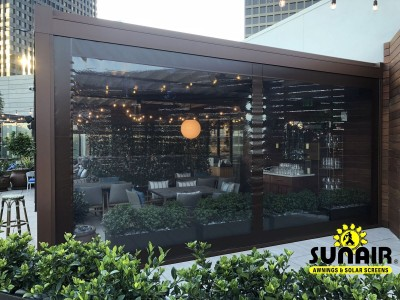 Retracted pergola awning over restaurant