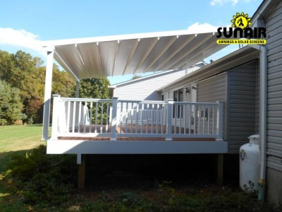 Pergola%20awning%20mounted%20on%20the%20roof%20and%20deck.JPG