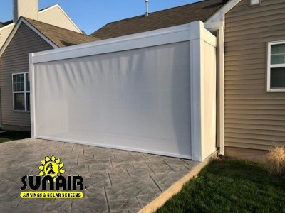 A white Awning covering the entrance to the garage