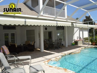 Retractable%20awning%20in%20screen%20enclosure%20by%20Sunair.JPG