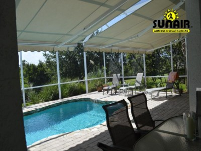 sunair%20retractable%20awning%20by%20screen%20enclosure.JPG
