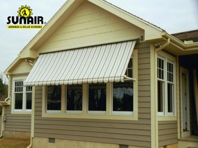 Maxi%20retractable%20window%20awning%20on%20siding.JPG