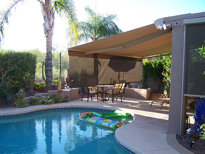backyard with awning that has a long extended piece and there is a pool