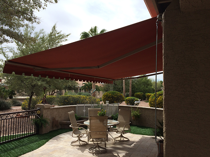 red sunchoice awning over a medium size patio