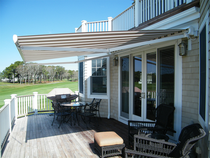 Cream And Brown Striped Awning Extended Over Residential Deck Area