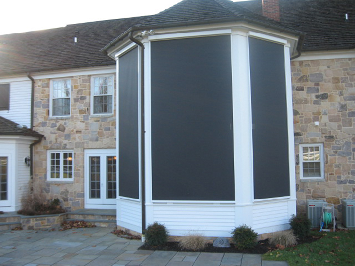 the backyard of a home with three large screens covering an entire bay window