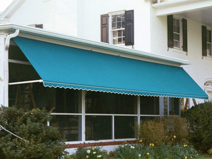 blue awning extended ovr a large group of windows