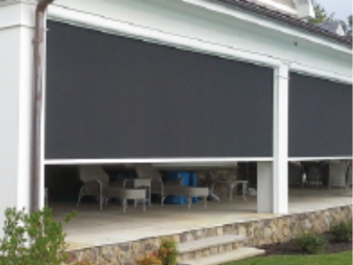 large screens that zipper are being shut on a large white front porch with stone steps
