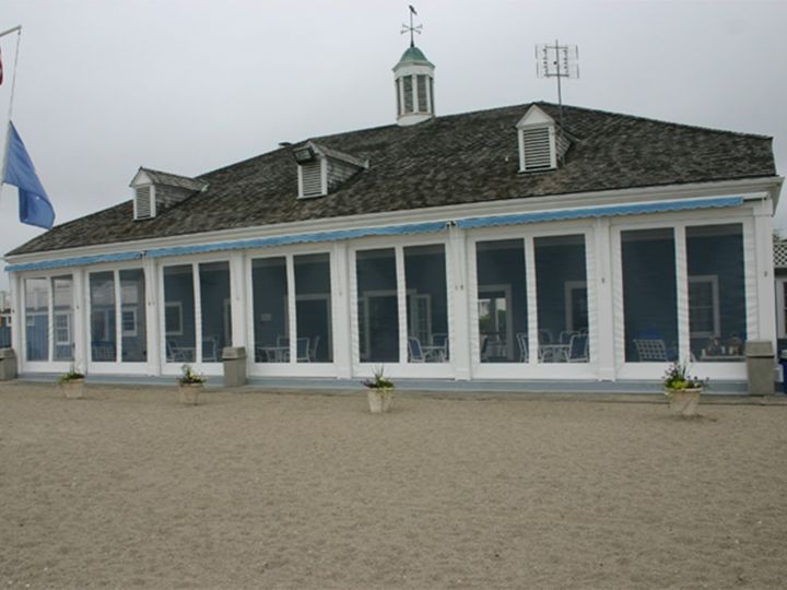Restaurant On A Beach With Sand Surround The Building And A Blue Flag  Hanging