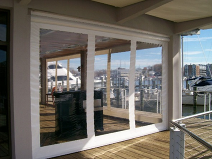 deck patio for a restaurant on a dock with zipper screens closed